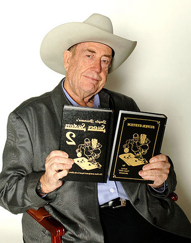Doyle Brunson and his two seminal strategy books on poker: Super System and Super System 2.