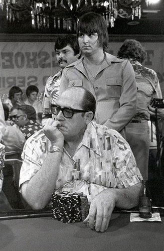 Doyle Brunon surveying the table action in during the earliest years of the WSOP.
