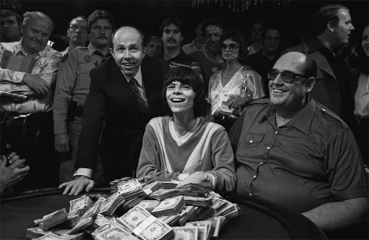 1980 World Series of Poker Champion Stu Ungar (center), Benny Binion (left), and Doyle Brunson (right). Ungar would win again in 1981 and then in 1997. He's still the only 3-time WSOP Main Event winner.