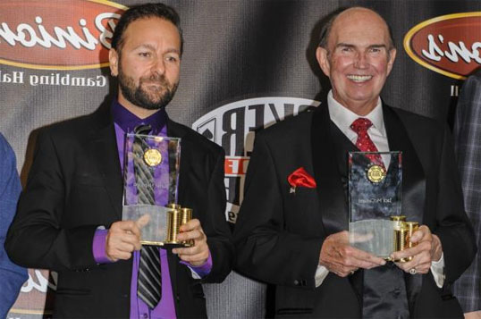 Daniel Negreanu and Jack McClelland receiving their Poker Hall of Fame trophies in 2014