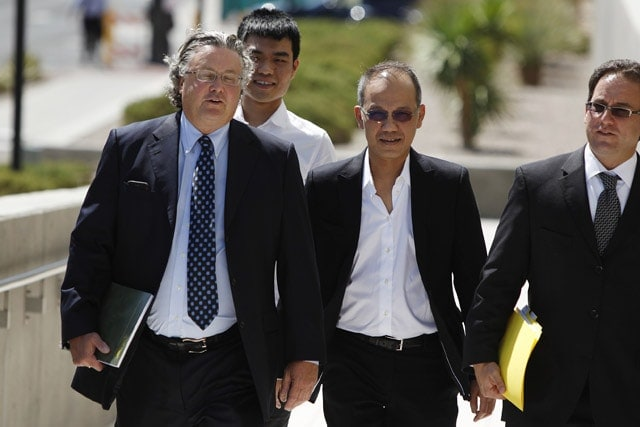 Paul Phua and his son Darren with their lawyers during trial in Las Vegas (source: scmp.com)